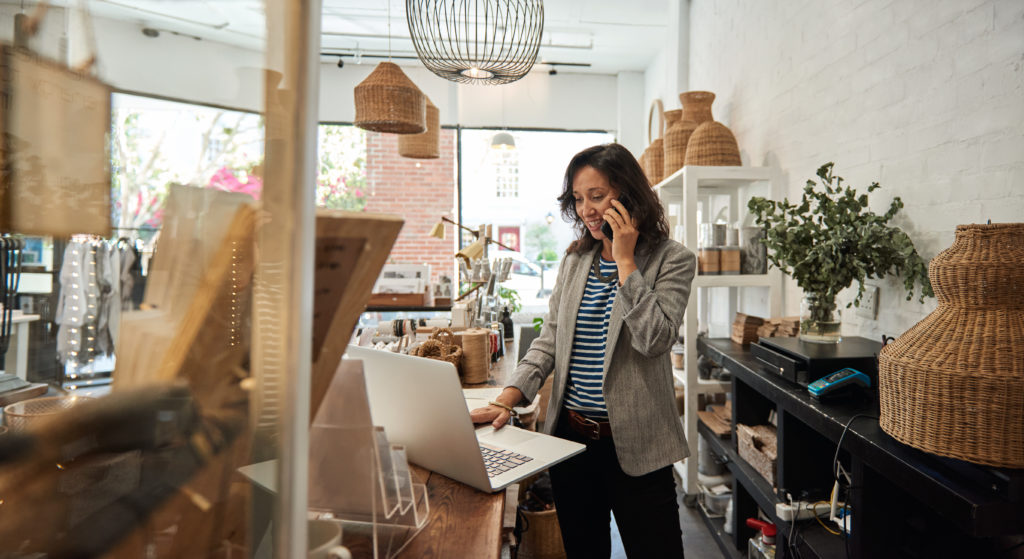 Lady working in small business store – demonstrating ecommerce integration